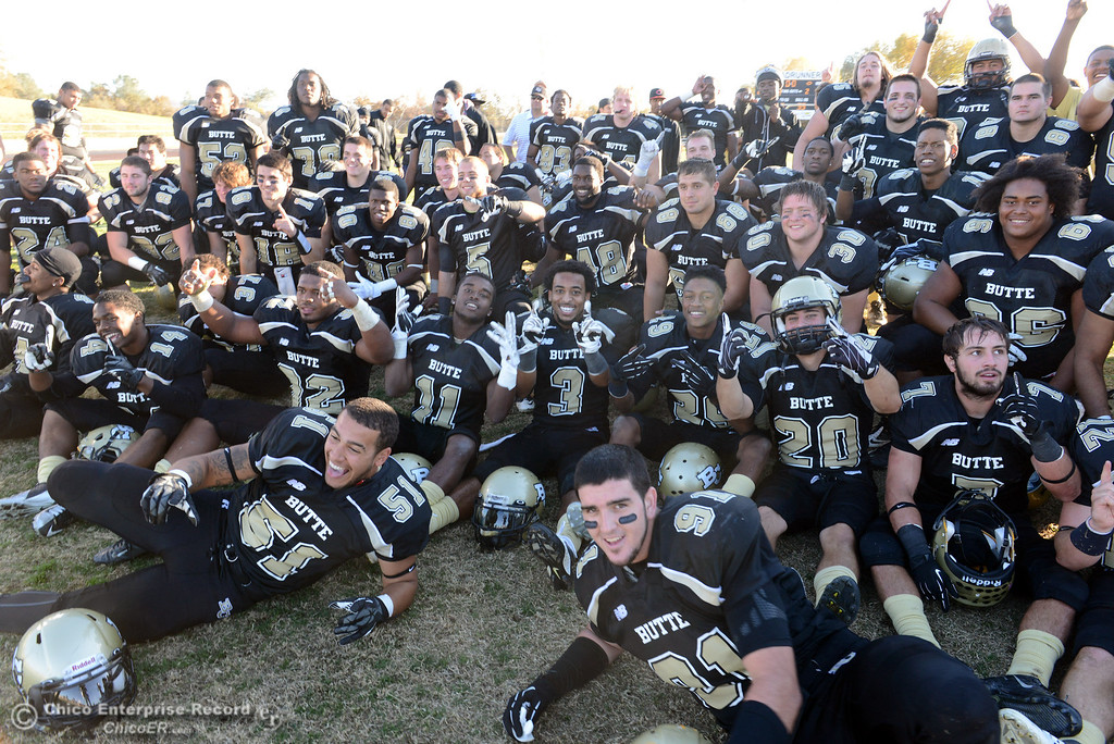 . Butte College team celebrate their win against Fresno City College at the end of their football game at Butte\'s Cowan Stadium Saturday, November 30, 2013 in Butte Valley, Calif.  (Jason Halley/Chico Enterprise-Record)