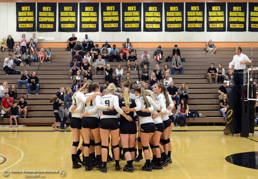 Description of . Butte College readies against Sac City College in the first game of their women's volleyball match at Butte's Cowan Gym Wednesday, September 25, 2013, in Oroville, Calif.  (Jason Halley/Chico Enterprise-Record)