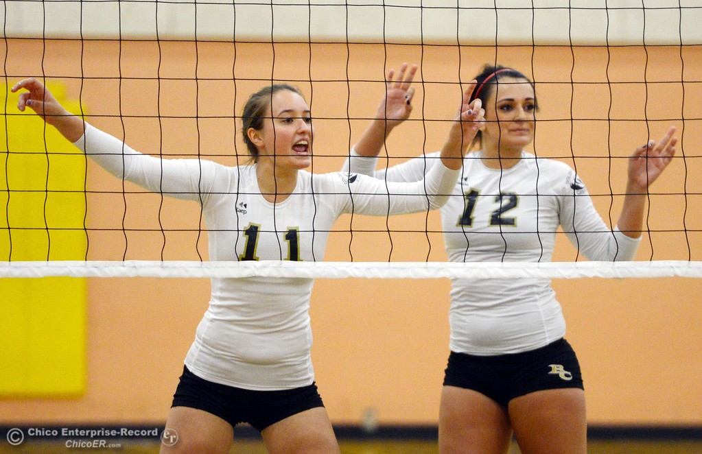 Description of . Butte College's #11 Brooke Silverman (left) and #12 Callie Flood (right) against Sac City College in the first game of their women's volleyball match at Butte's Cowan Gym Wednesday, September 25, 2013, in Oroville, Calif.  (Jason Halley/Chico Enterprise-Record)