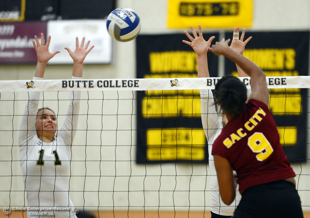 Description of . Butte College\'s #11 Brooke Silverman (left) blocks against Sac City College\'s #9 Elliza North (right) in the second game of their women\'s volleyball match at Butte\'s Cowan Gym Wednesday, September 25, 2013, in Oroville, Calif.  (Jason Halley/Chico Enterprise-Record)