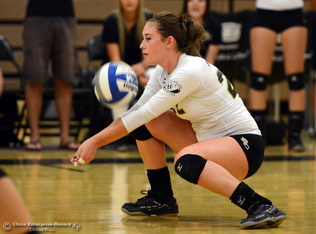 Description of . Butte College's #22 Courtney Robinson takes a dig against Sac City College in the first game of their women's volleyball match at Butte's Cowan Gym Wednesday, September 25, 2013, in Oroville, Calif.  (Jason Halley/Chico Enterprise-Record)