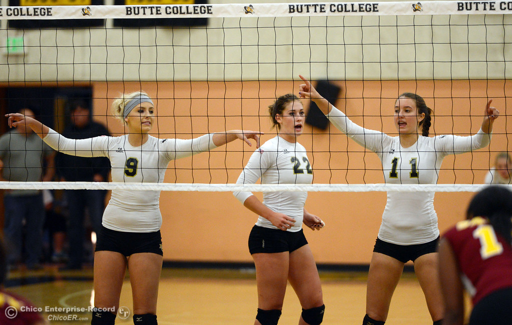 Description of . Butte College's #9 Colleen Tade, #22 Courtney Robinson, and #11 Brooke Silverman (left to right) ready against Sac City College in the first game of their women's volleyball match at Butte's Cowan Gym Wednesday, September 25, 2013, in Oroville, Calif.  (Jason Halley/Chico Enterprise-Record)