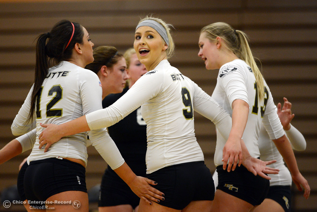 Description of . Butte College's #9 Colleen Tade (center) looks back at the official after the team scored against Sac City College in the second game of their women's volleyball match at Butte's Cowan Gym Wednesday, September 25, 2013, in Oroville, Calif.  (Jason Halley/Chico Enterprise-Record)