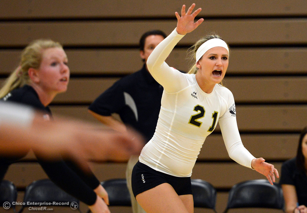 Description of . Butte College's #21 Drew Tattam calls out for the ball against Sac City College in the second game of their women's volleyball match at Butte's Cowan Gym Wednesday, September 25, 2013, in Oroville, Calif.  (Jason Halley/Chico Enterprise-Record)