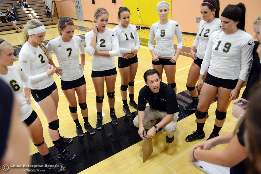 Description of . Butte College head coach David Davis talks to the team against Sac City College in the second game of their women's volleyball match at Butte's Cowan Gym Wednesday, September 25, 2013, in Oroville, Calif.  (Jason Halley/Chico Enterprise-Record)