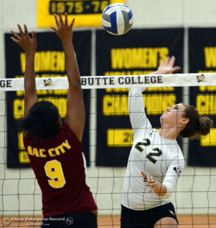 Description of . Butte College\'s #22 Courtney Robinson (right) spikes against Sac City College\'s #9 Elliza North (left) in the second game of their women\'s volleyball match at Butte\'s Cowan Gym Wednesday, September 25, 2013, in Oroville, Calif.  (Jason Halley/Chico Enterprise-Record)