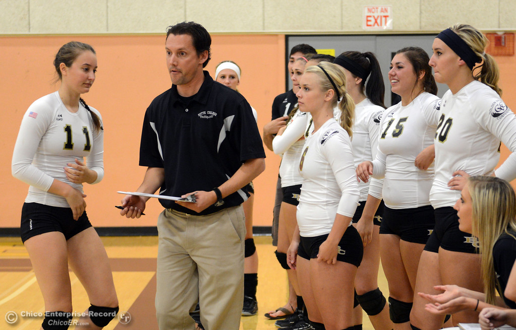 Description of . Butte College head coach David Davis prepares the team against Sac City College in the second game of their women\'s volleyball match at Butte\'s Cowan Gym Wednesday, September 25, 2013, in Oroville, Calif.  (Jason Halley/Chico Enterprise-Record)