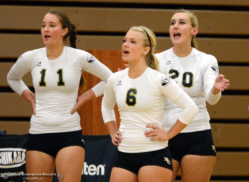 Description of . Butte College's #11 Brooke Silverman, #6 Lacie Landrum, and #20 Erika Click (left to right) cheer on the team against Sac City College in the first game of their women's volleyball match at Butte's Cowan Gym Wednesday, September 25, 2013, in Oroville, Calif.  (Jason Halley/Chico Enterprise-Record)