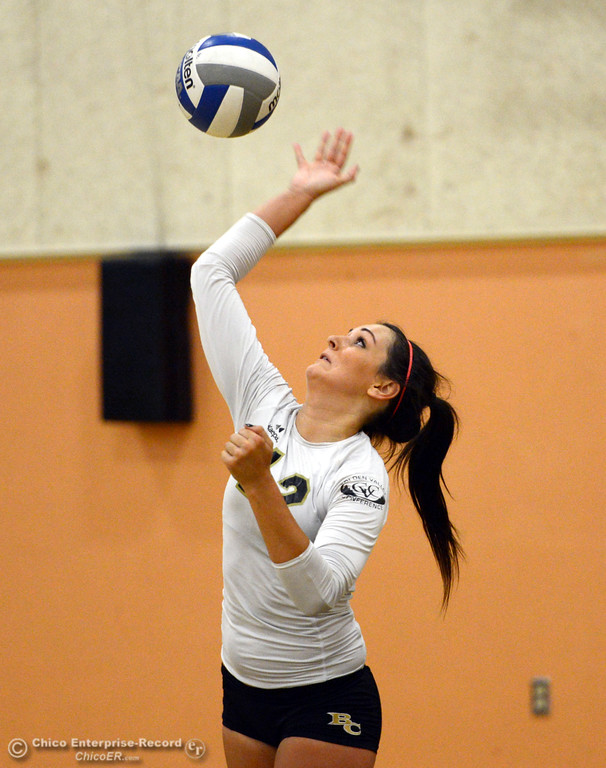 Description of . Butte College's #12 Callie Flood serves against Sac City College in the second game of their women's volleyball match at Butte's Cowan Gym Wednesday, September 25, 2013, in Oroville, Calif.  (Jason Halley/Chico Enterprise-Record)