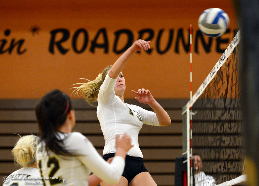 Description of . Butte College's #13 Emilie Aase spikes against Sac City College in the second game of their women's volleyball match at Butte's Cowan Gym Wednesday, September 25, 2013, in Oroville, Calif.  (Jason Halley/Chico Enterprise-Record)