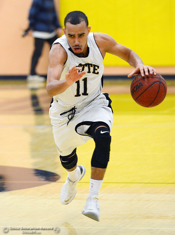 Description of . Butte College\'s #11 Jamaal Davis dribbles against San Jose City College in the first half of their men\'s basketball game at Butte\'s Cowan Gym Friday, February 28, 2014 in Oroville, Calif.  (Jason Halley-Chico Enterprise-Record)