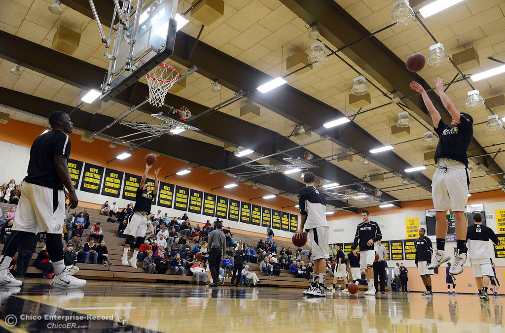 Description of . Butte College warms up against San Jose City College before the first half of their men\'s basketball game at Butte\'s Cowan Gym Friday, February 28, 2014 in Oroville, Calif.  (Jason Halley-Chico Enterprise-Record)