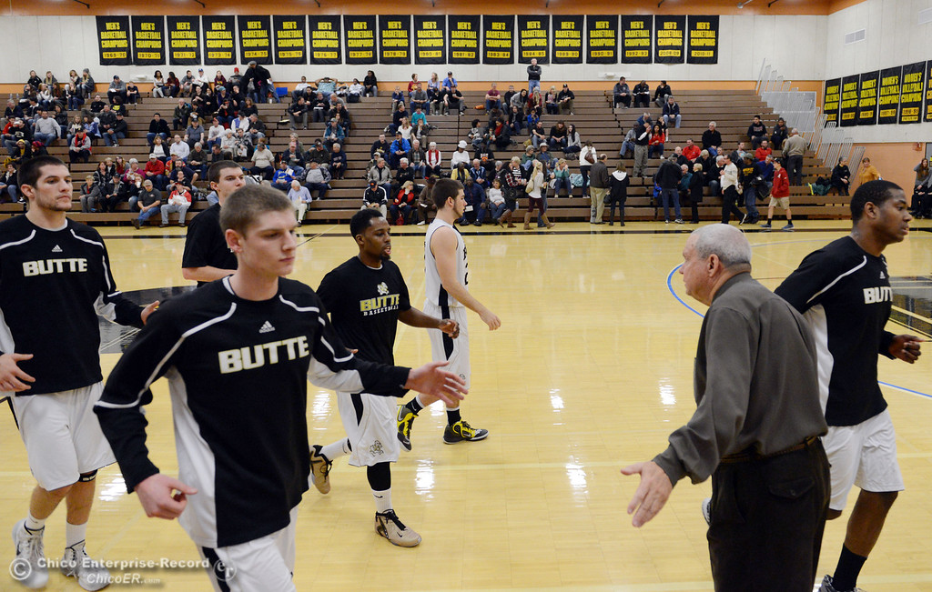 Description of . Butte College coach Russ Critchfield (right) high-fives the team after warming up against San Jose City College before the first half of their men\'s basketball game at Butte\'s Cowan Gym Friday, February 28, 2014 in Oroville, Calif.  (Jason Halley-Chico Enterprise-Record)