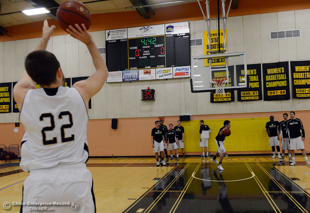 Description of . Butte College #22 Jud Sailsbery (left) warms up against San Jose City College before the first half of their men\'s basketball game at Butte\'s Cowan Gym Friday, February 28, 2014 in Oroville, Calif.  (Jason Halley-Chico Enterprise-Record)