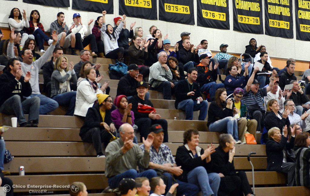 Description of . Butte College fans cheer on against San Jose City College in the first half of their men\'s basketball game at Butte\'s Cowan Gym Friday, February 28, 2014 in Oroville, Calif.  (Jason Halley-Chico Enterprise-Record)