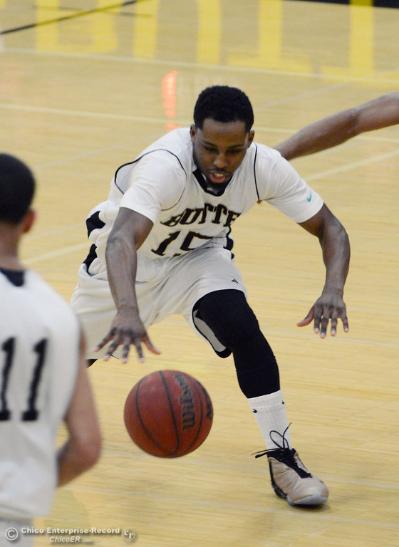 Description of . Butte College\'s #15 Nate Hurd dribbles against San Jose City College in the first half of their men\'s basketball game at Butte\'s Cowan Gym Friday, February 28, 2014 in Oroville, Calif.  (Jason Halley-Chico Enterprise-Record)