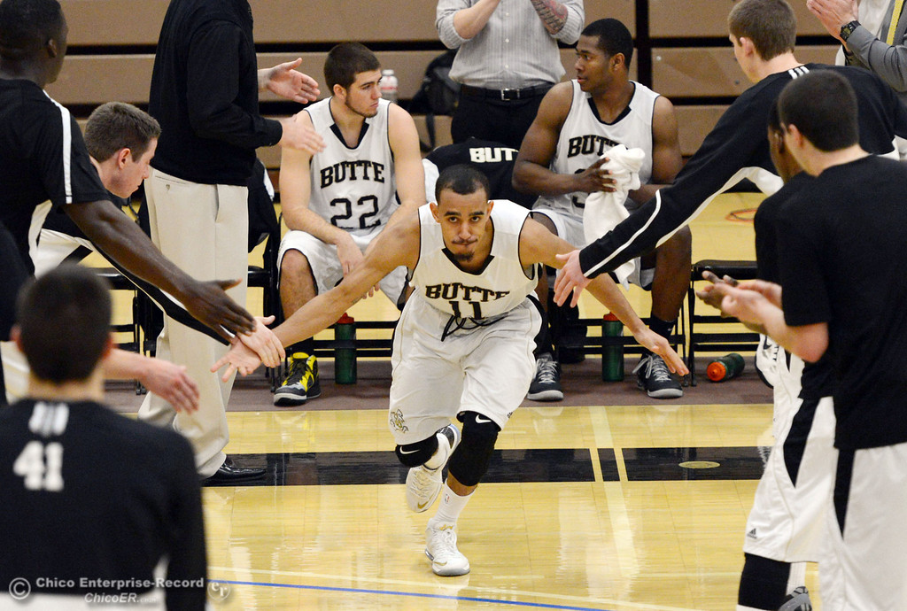 Description of . Butte College\'s #11 Jamaal Davis (center) is introduced against San Jose City College before the first half of their men\'s basketball game at Butte\'s Cowan Gym Friday, February 28, 2014 in Oroville, Calif.  (Jason Halley-Chico Enterprise-Record)