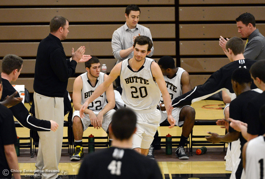 Description of . Butte College\'s #20 Justin Gavard (center) is introduced against San Jose City College before the first half of their men\'s basketball game at Butte\'s Cowan Gym Friday, February 28, 2014 in Oroville, Calif.  (Jason Halley-Chico Enterprise-Record)