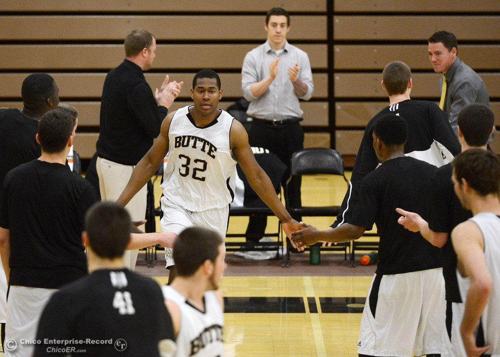 Description of . Butte College\'s #32 Arthur Caldwell (center) is introduced against San Jose City College before the first half of their men\'s basketball game at Butte\'s Cowan Gym Friday, February 28, 2014 in Oroville, Calif.  (Jason Halley-Chico Enterprise-Record)