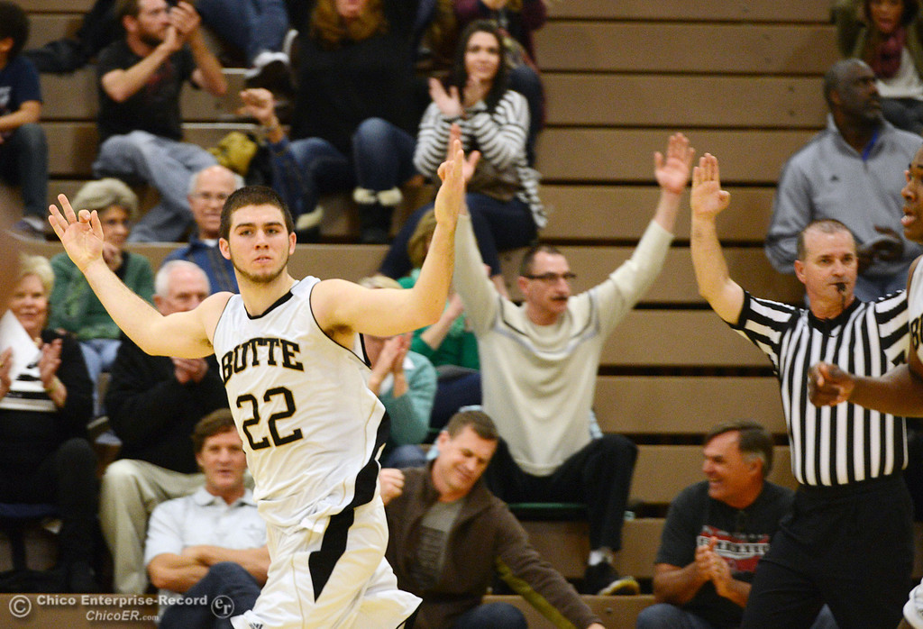 Description of . Butte College\'s #22 Jud Sailsbery reacts to making a 3-pt shot against San Jose City College in the second half of their men\'s basketball game at Butte\'s Cowan Gym Friday, February 28, 2014 in Oroville, Calif.  (Jason Halley-Chico Enterprise-Record)