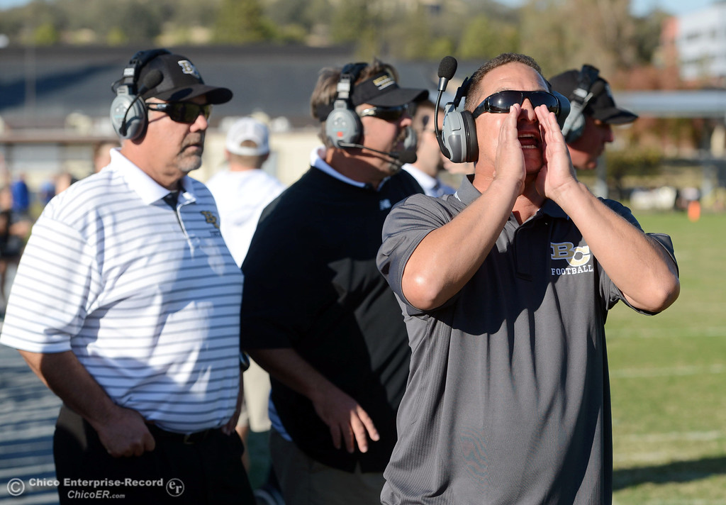 . Butte College coaches Willie Thomas (left) and Jeff Jordan (center) stand behind Tim Garcia (right)against College of San Mateo in the fourth quarter of their football game at Butte\'s Cowan Stadium Saturday, November 2, 2013 in Oroville, Calif.  (Jason Halley/Chico Enterprise-Record)
