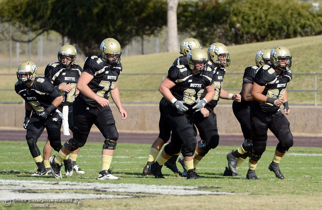 . Butte College offensive line moves in against College of San Mateo in the second quarter of their football game at Butte\'s Cowan Stadium Saturday, November 2, 2013 in Oroville, Calif.  (Jason Halley/Chico Enterprise-Record)