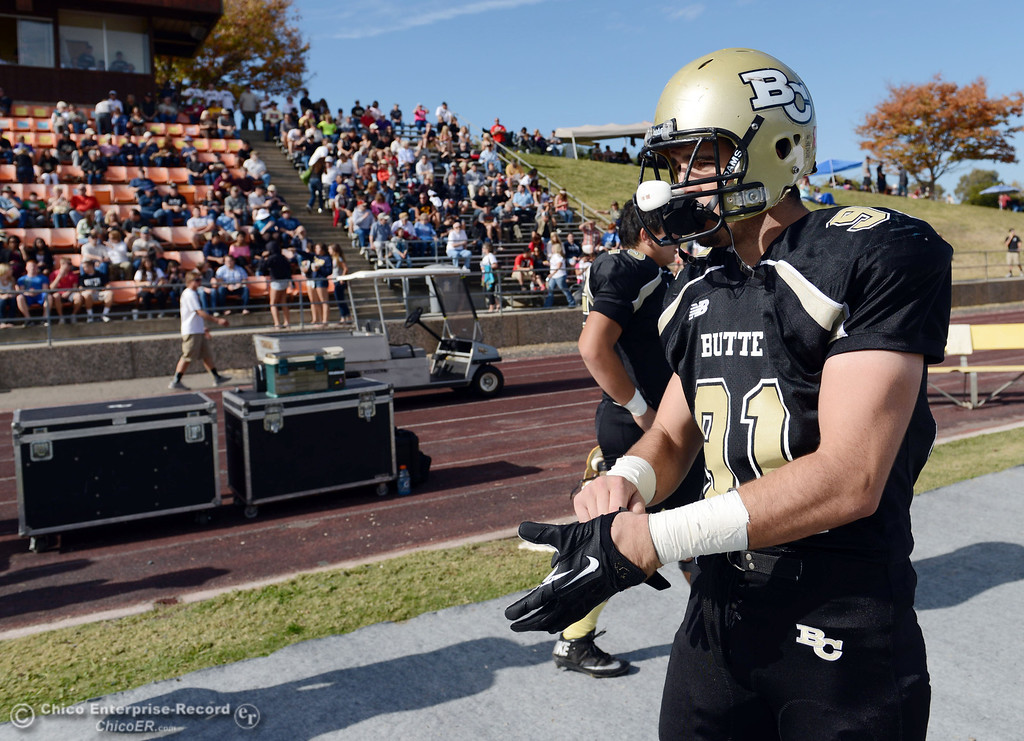 . Butte College\'s #91 Miek Fratianni on the sidelines against San Mateo College in the first quarter of their football game at Butte\'s Cowan Stadium Saturday, November 2, 2013 in Oroville, Calif.  (Jason Halley/Chico Enterprise-Record)