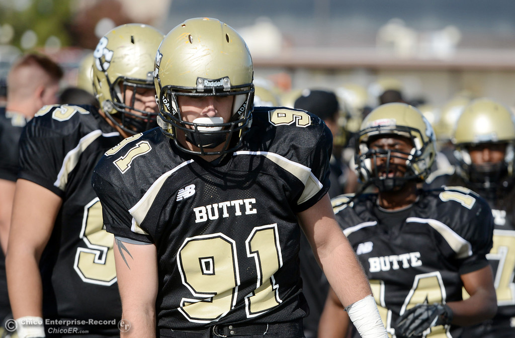 . Butte College\'s #91 Mike Fratianni looks on against College of San Mateo in the second quarter of their football game at Butte\'s Cowan Stadium Saturday, November 2, 2013 in Oroville, Calif.  (Jason Halley/Chico Enterprise-Record)