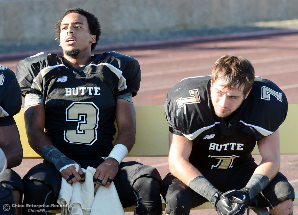 . Butte College\'s #3 London Muse (left) and #7 Ryan Holland (right) against College of San Mateo in the fourth quarter of their football game at Butte\'s Cowan Stadium Saturday, November 2, 2013 in Oroville, Calif.  (Jason Halley/Chico Enterprise-Record)