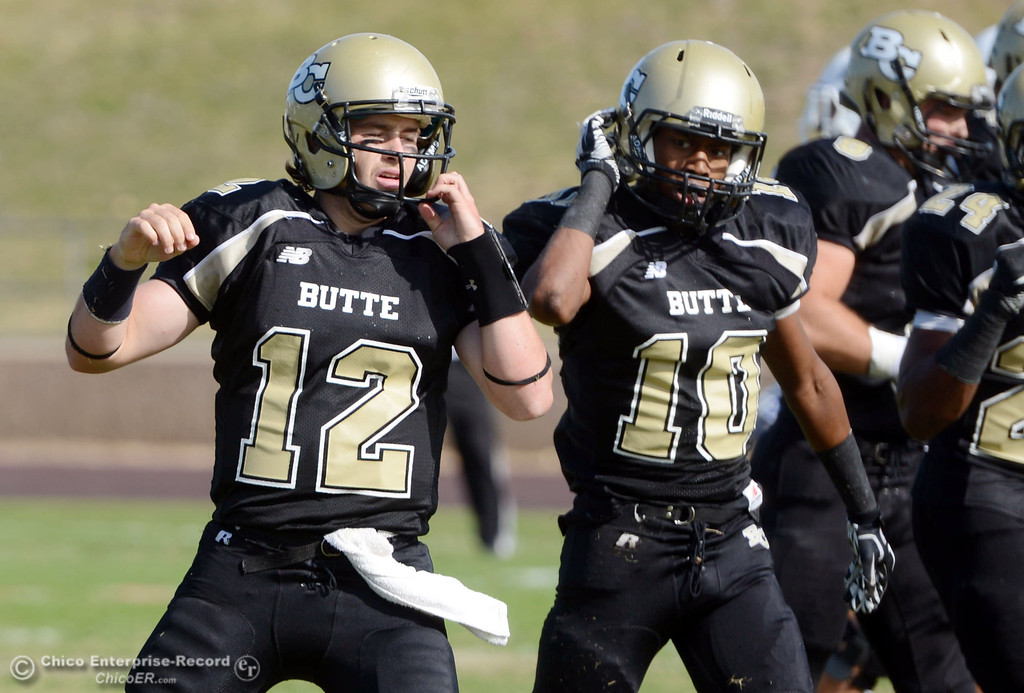 . Butte College\'s #12 Thomas Stuart (left) and #10 CJ Grice (right) against San Mateo College in the first quarter of their football game at Butte\'s Cowan Stadium Saturday, November 2, 2013 in Oroville, Calif.  (Jason Halley/Chico Enterprise-Record)