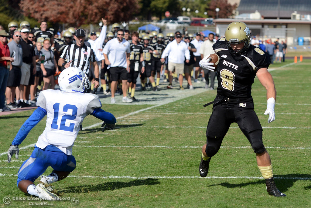 . Butte College\'s #8 Bo Brummel (right) scores a touchdown against San Mateo College\'s #12 Taylor Mashack (left) in the second quarter of their football game at Butte\'s Cowan Stadium Saturday, November 2, 2013 in Oroville, Calif.  (Jason Halley/Chico Enterprise-Record)