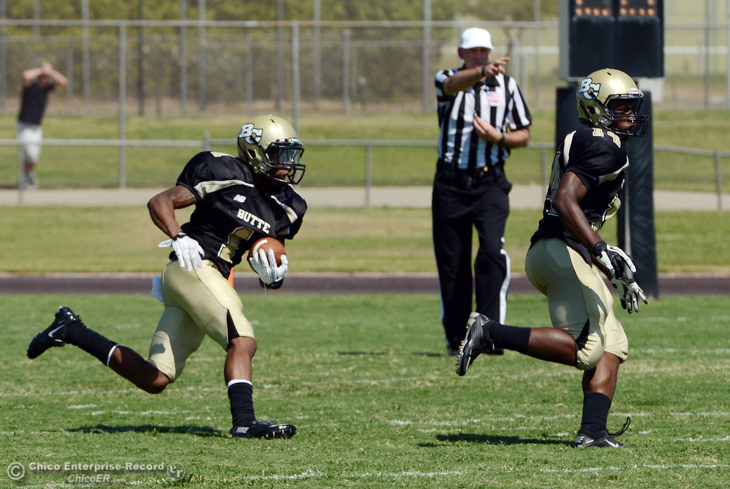 Description of . Butte College's #1 Wes McCoy rushes behind #14 Robert Frazier (right) against College of the Siskiyous in the first quarter of their football game at Butte's Cowan Stadium on Saturday, September 14, 2013, in Oroville, Calif. (Jason Halley/Chico Enterprise-Record)