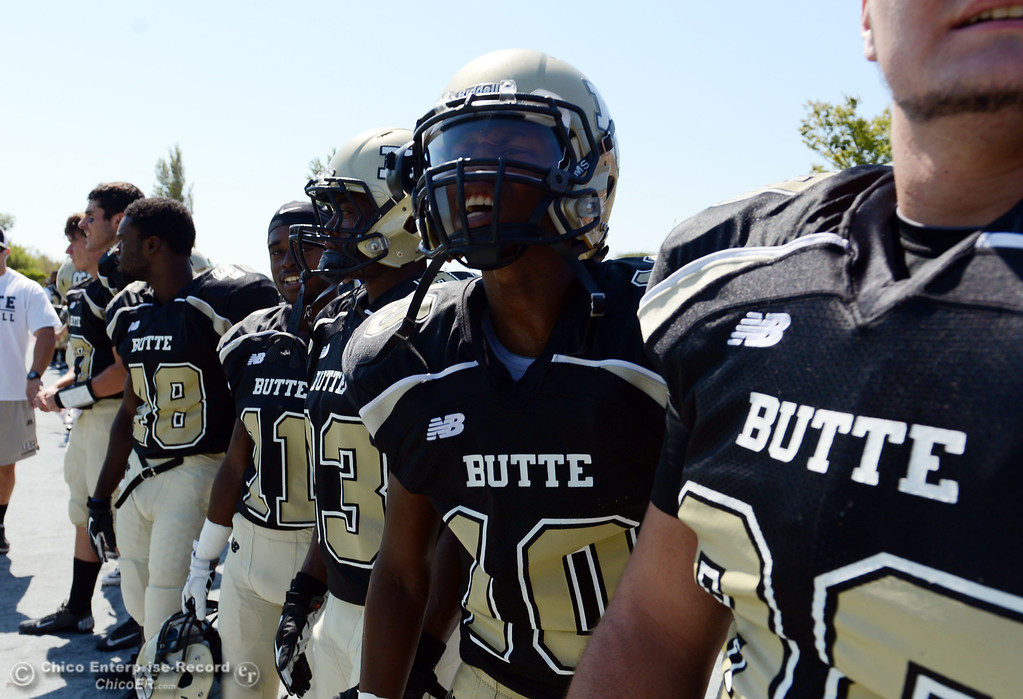 Description of . Butte College's #10 CJ Grice (center) pumps up the team against College of the Siskiyous before the first quarter of their football game at Butte's Cowan Stadium on Saturday, September 14, 2013, in Oroville, Calif. (Jason Halley/Chico Enterprise-Record)