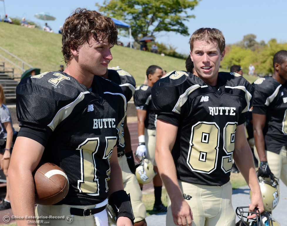 Description of . Butte College's #17 Peter Wysong (left) and #89 Brandon Smith (right) look on against College of the Siskiyous before the first quarter of their football game at Butte's Cowan Stadium on Saturday, September 14, 2013, in Oroville, Calif. (Jason Halley/Chico Enterprise-Record)