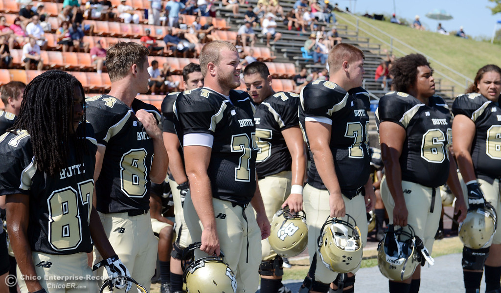 Description of . Butte College's #87 Timazray Shepherd, #84 Alex Alves, #77 Scott Batchelder #76 Kevin Camy, #68 Eli Thom, and #64 Jess Savusa (left to right) look on against College of the Siskiyous before the first quarter of their football game at Butte's Cowan Stadium on Saturday, September 14, 2013, in Oroville, Calif. (Jason Halley/Chico Enterprise-Record)