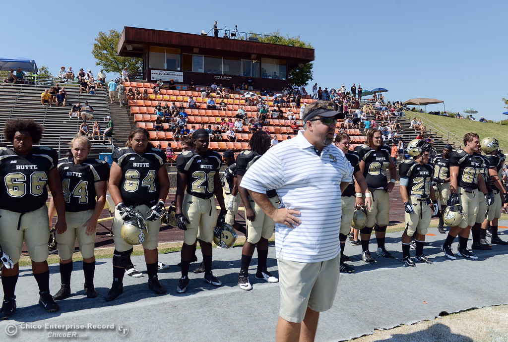 Description of . Butte College head coach Jeff Jordan looks on against College of the Siskiyous before the first quarter of their football game at Butte's Cowan Stadium on Saturday, September 14, 2013, in Oroville, Calif. (Jason Halley/Chico Enterprise-Record)