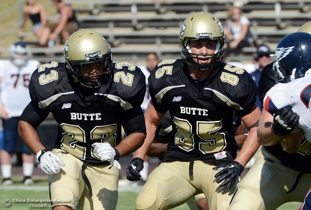 Description of . Butte College's #23 Mykah Hester (left) and #85 Richard Murphy (right) against College of the Siskiyous in the fourth quarter of their football game at Butte's Cowan Stadium on Saturday, September 14, 2013, in Oroville, Calif. (Jason Halley/Chico Enterprise-Record)