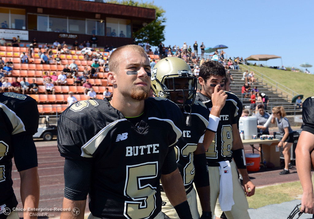 Description of . Butte College's #5 David Brannon looks on against College of the Siskiyous before the first quarter of their football game at Butte's Cowan Stadium on Saturday, September 14, 2013, in Oroville, Calif. (Jason Halley/Chico Enterprise-Record)