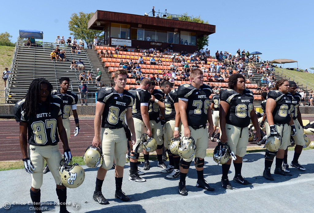 Description of . Butte College's #87 Timazray Shepherd, #84 Alex Alves, #76 Kevin Camy, #68 Eli Thom, and #64 Jess Savusa (left to right) look on against College of the Siskiyous before the first quarter of their football game at Butte's Cowan Stadium on Saturday, September 14, 2013, in Oroville, Calif. (Jason Halley/Chico Enterprise-Record)
