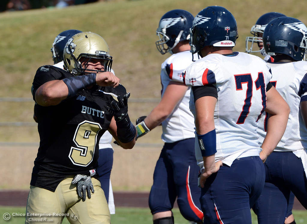 Description of . Butte College's #9 Tyler Adair reacts to making a tackle against College of the Siskiyous in the third quarter of their football game at Butte's Cowan Stadium on Saturday, September 14, 2013, in Oroville, Calif. (Jason Halley/Chico Enterprise-Record)