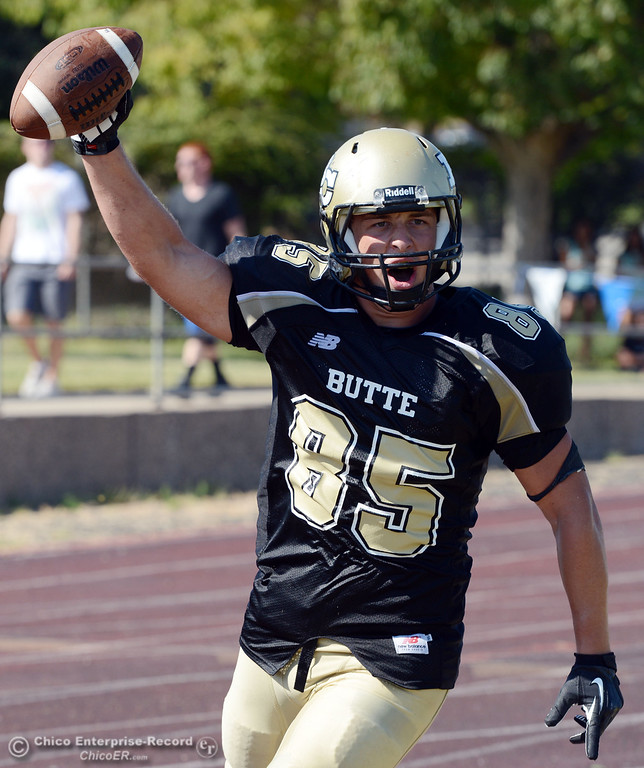 Description of . Butte College's #85 Richard Murphy reacts to a touchdown against College of the Siskiyous in the third quarter of their football game at Butte's Cowan Stadium on Saturday, September 14, 2013, in Oroville, Calif. (Jason Halley/Chico Enterprise-Record)