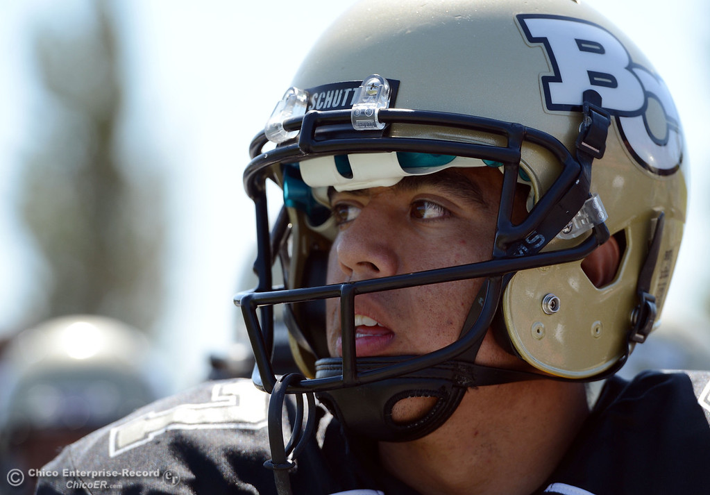 Description of . Butte College's #27 Rigoberto Sanchez looks on against College of the Siskiyous in the first quarter of their football game at Butte's Cowan Stadium on Saturday, September 14, 2013, in Oroville, Calif. (Jason Halley/Chico Enterprise-Record)