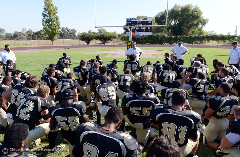 Description of . Butte College head coach Jeff Jordan (center) talks to the team at the end of their football game against College of the Siskiyous at Butte's Cowan Stadium on Saturday, September 14, 2013, in Oroville, Calif. (Jason Halley/Chico Enterprise-Record)