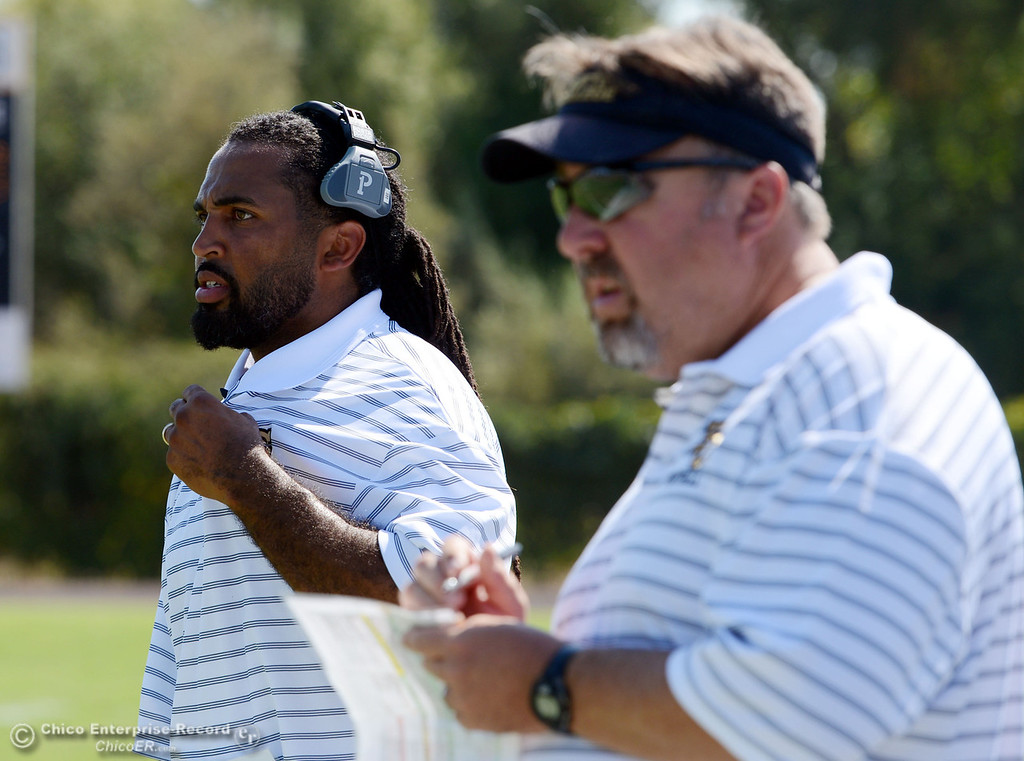 Description of . Butte College coaches Bobby Bernal (left) and Jeff Jordan (right) look on against College of the Siskiyous in the second quarter of their football game at Butte's Cowan Stadium on Saturday, September 14, 2013, in Oroville, Calif. (Jason Halley/Chico Enterprise-Record)