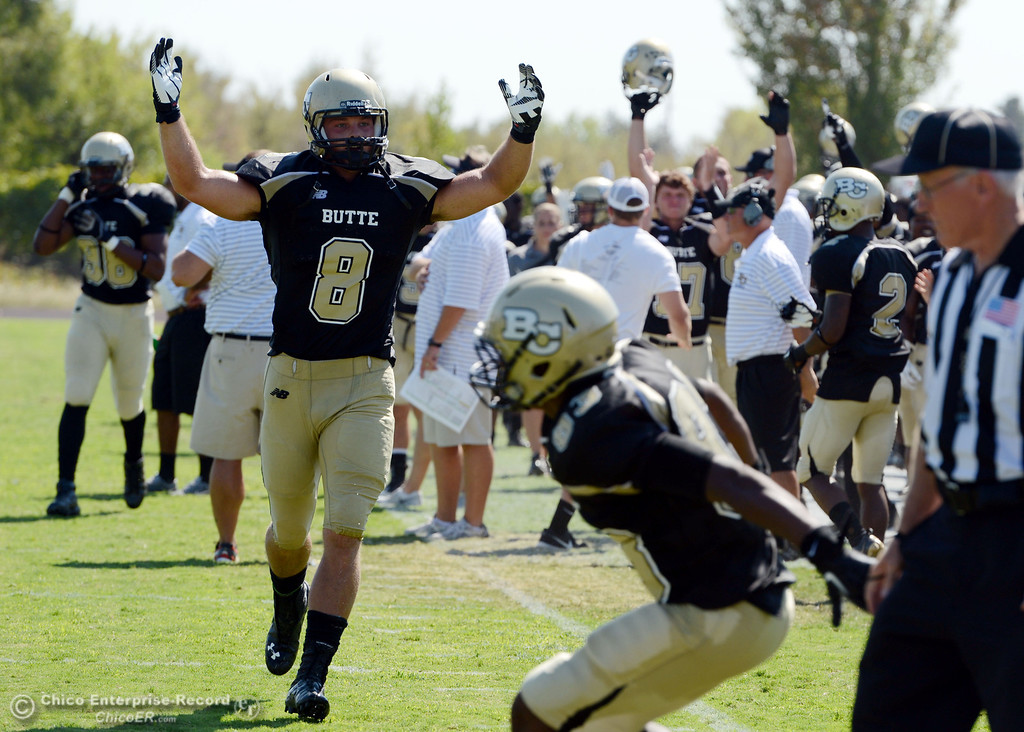 Description of . Butte College's #8 Bo Brummel reacts to a touchdown against College of the Siskiyous in the second quarter of their football game at Butte's Cowan Stadium on Saturday, September 14, 2013, in Oroville, Calif. (Jason Halley/Chico Enterprise-Record)