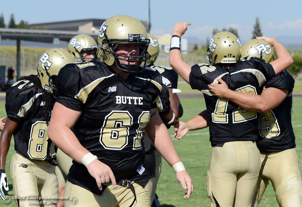 Description of . Butte College's #61 Jacob Bigham comes off the field against College of the Siskiyous in the third quarter of their football game at Butte's Cowan Stadium on Saturday, September 14, 2013, in Oroville, Calif. (Jason Halley/Chico Enterprise-Record)