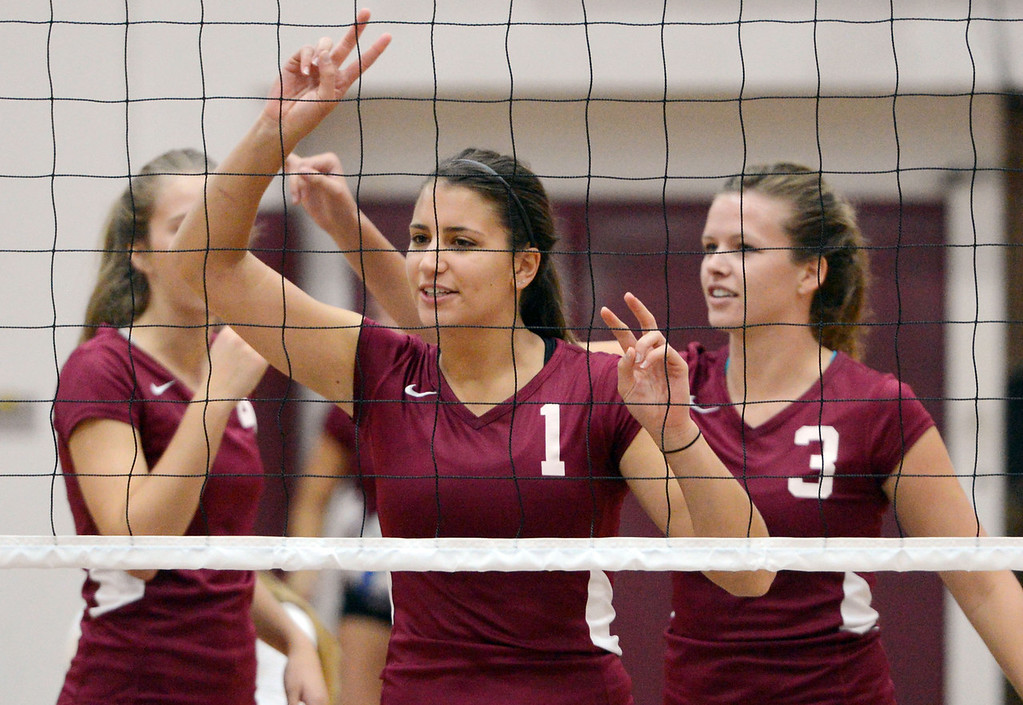 Description of . Chico State's #1 Kristyn Casalino (center) and #3 Haley Uhland (right) ready against Butte College in their volleyball game at CSUC Acker Gym Saturday, August 24, 2013 in Chico, Calif.  (Jason Halley/Chico Enterprise-Record)