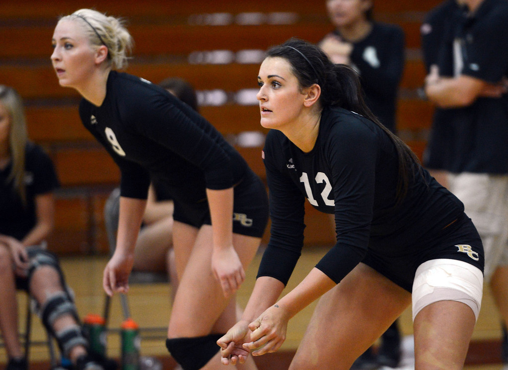 Description of . Butte College's #9 Colleen Tade (left) and #12 Callie Flood (right) ready against Chico State in their volleyball game at CSUC Acker Gym Saturday, August 24, 2013 in Chico, Calif.  (Jason Halley/Chico Enterprise-Record)