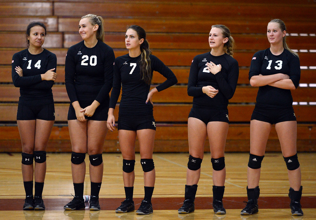 Description of . Butte College's #14 Gabby Delarosa, #20 Erika Click, #7 Taylor Johnson, #21 Drew Tattam, and #13 Emilie Aase (left to right) look on against Chico State in their volleyball game at CSUC Acker Gym Saturday, August 24, 2013 in Chico, Calif.  (Jason Halley/Chico Enterprise-Record)