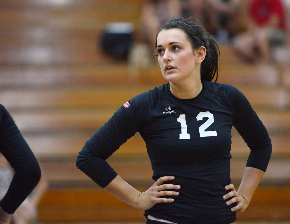 Description of . Butte College's #12 Callie Flood against Chico State in their volleyball game at CSUC Acker Gym Saturday, August 24, 2013 in Chico, Calif.  (Jason Halley/Chico Enterprise-Record)